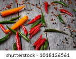 red and green chilli on wooden... | Shutterstock . vector #1018126561