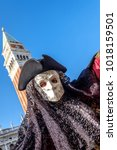 Small photo of The Larva, a traditional Venetian mask posing in Piazza San Marco during the Volo dell'Angelo event. Venice, Italy. February 4, 2018