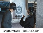 shooting instructor pointing on ... | Shutterstock . vector #1018165534