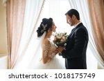 lovers of beautiful couple... | Shutterstock . vector #1018175749