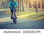woman cyclist riding bike with... | Shutterstock . vector #1018181194
