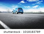 a blue crossover car on the... | Shutterstock . vector #1018183789