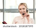 pretty female customer support... | Shutterstock . vector #1018187395