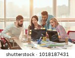 young web designers looking at... | Shutterstock . vector #1018187431