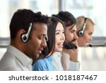 four support phone operators at ... | Shutterstock . vector #1018187467