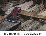 closep of hatchet axe lying on... | Shutterstock . vector #1018202869