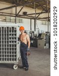 worker at the window factory | Shutterstock . vector #1018202929