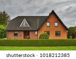 red brick house in the german... | Shutterstock . vector #1018212385