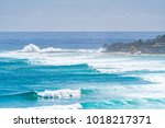 a busy day with large swell at... | Shutterstock . vector #1018217371