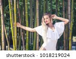 beautiful young woman in spring ... | Shutterstock . vector #1018219024