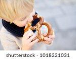 little tourist eating...   Shutterstock . vector #1018221031