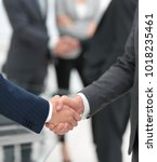 two businessmen shaking hands... | Shutterstock . vector #1018235461