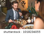handsome man with his wife in... | Shutterstock . vector #1018236055