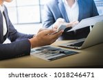 business partners discussing... | Shutterstock . vector #1018246471
