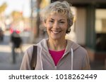 mature woman smiling face on a... | Shutterstock . vector #1018262449