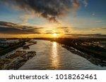 riverside at sunset | Shutterstock . vector #1018262461