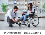 disabled patient on wheelchair... | Shutterstock . vector #1018263541