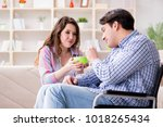 young family taking care of... | Shutterstock . vector #1018265434