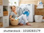 a happy housewife woman in... | Shutterstock . vector #1018283179