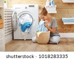 a happy housewife woman in... | Shutterstock . vector #1018283335