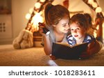 reading and family games in  ... | Shutterstock . vector #1018283611