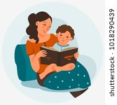 young mother with baby reading... | Shutterstock .eps vector #1018290439