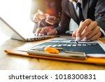 business team meeting present... | Shutterstock . vector #1018300831