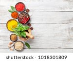 various spices and herbs on... | Shutterstock . vector #1018301809