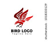 abstract red eagle catch logo   Shutterstock .eps vector #1018333129