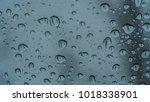 water drop on glass backgrounds | Shutterstock . vector #1018338901