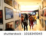 Small photo of Palembang, Indonesia - January 5, 2013: visitors are viewing photos in a flashback photo exhibit 2012