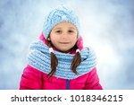 closeup winter portrait of cute ... | Shutterstock . vector #1018346215