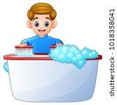happy boy cleaning bathtub on a ... | Shutterstock .eps vector #1018358041