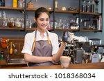 asian barista woman make a...   Shutterstock . vector #1018368034