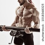 exercise for triceps in the gym.... | Shutterstock . vector #1018368325