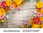 flowers composition on wooden... | Shutterstock . vector #1018372687