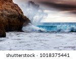 wave is broken against the... | Shutterstock . vector #1018375441
