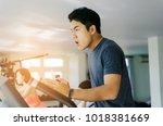 muscular young asian man... | Shutterstock . vector #1018381669
