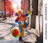 little boy dressed as a clown. | Shutterstock . vector #1018385671