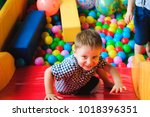 boys playing on the playground  ... | Shutterstock . vector #1018396351