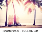 surfboard and palm tree on... | Shutterstock . vector #1018407235