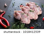 fresh  raw meat quails ready... | Shutterstock . vector #1018412539