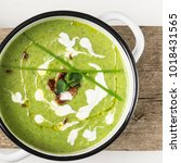 green pea soup puree with mint... | Shutterstock . vector #1018431565