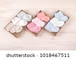 many pairs of child's striped... | Shutterstock . vector #1018467511