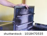 man cleaning wood burning stove.... | Shutterstock . vector #1018470535