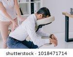 masseuse doing back massage on... | Shutterstock . vector #1018471714