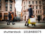 anonymous motion blurred... | Shutterstock . vector #1018480075