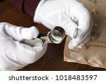 jeweler working in workshop ... | Shutterstock . vector #1018483597