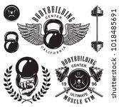 set of bodybuilding emblems... | Shutterstock . vector #1018485691