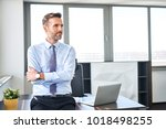 ceo  manager standing at modern ... | Shutterstock . vector #1018498255